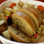 Sliced Tofurkey roast in a baking dish