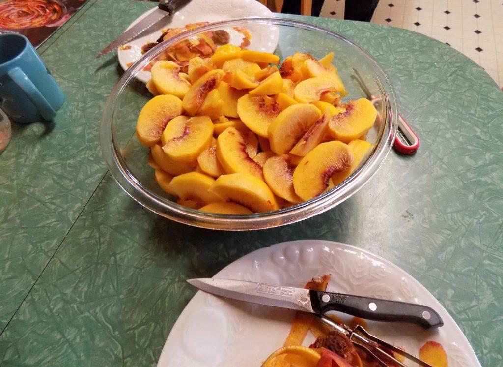 Sliced peaches on table