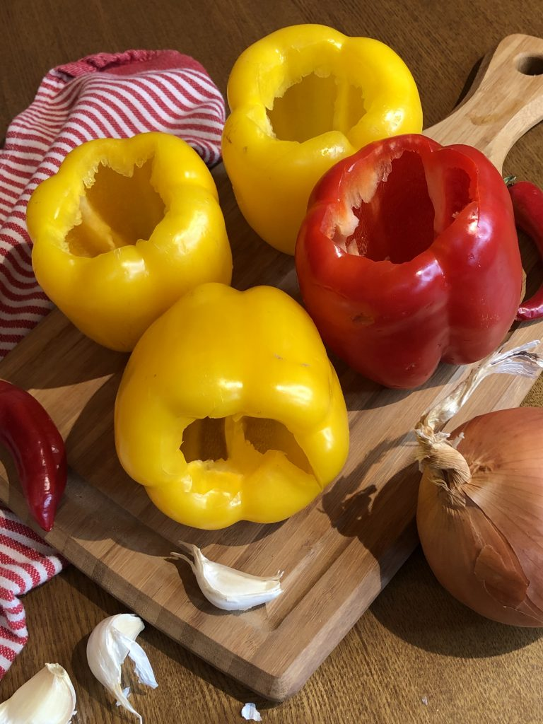 Red and yellow peppers to be stuffed